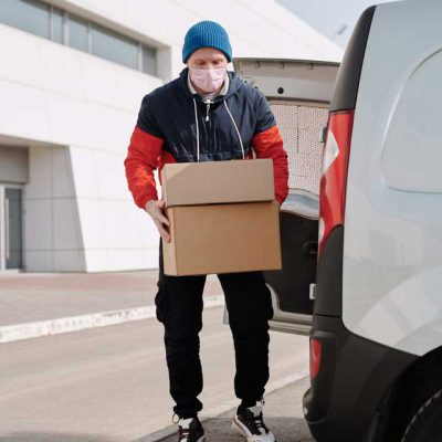 delivery-man-wearing-a-face-mask-carrying-boxes-4391479